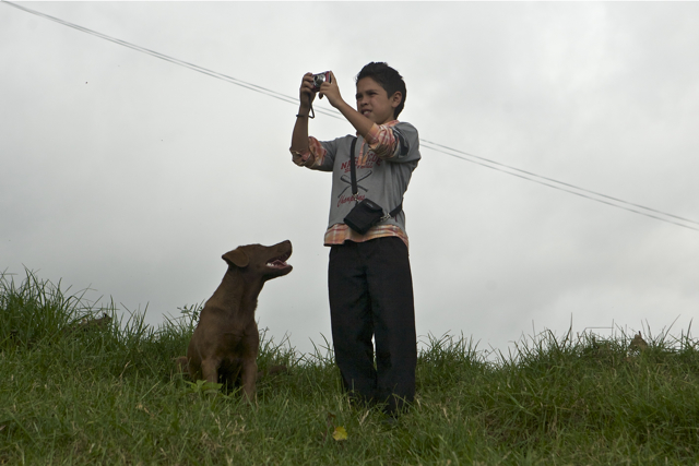 Miguelito W Camera And Dog